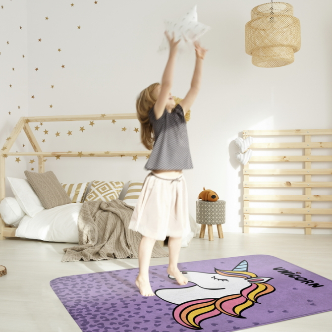 Little girl playing in a cozy modern bedroom
